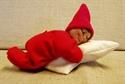 Billede af sovende nissebaby 16 cm.